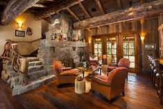 I absolutely love the wood beams and a staircase that wraps around a stone fireplace!