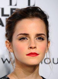 Emma Watson's windswept updo and crimson pout.