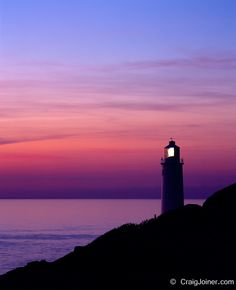 Silhouette of the lighthouse at Trevose Head at dusk on the North Cornwall coast near Padstow, Cornwall, England, United Kingdom.
