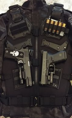 Great load out displayed here. A custom 1911 45 cal along an Austrian Glock. The vest itself looks mobile and set up for a shotgun primary. The custom punisher logo in the grip is spot on. Weapons Guns, Guns And Ammo, Custom 1911, Tactical Armor, Weapon Storage, Combat Gear, Fire Powers, Military Guns, Armor Concept