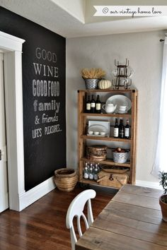 Rustic style. Chalkboard wall, barnwood and farmhouse style table