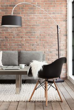 Create an industrial-cool space by mixing materials: metal, concrete, woods and soft furnishings.