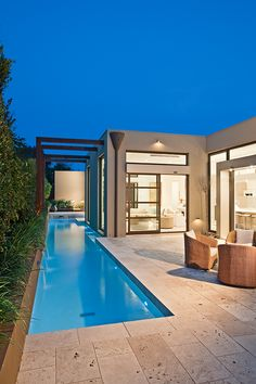 I like idea of lap pool on side of house that connects to family pool in back yard.