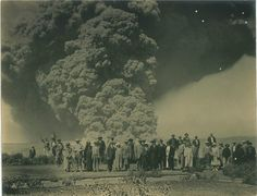 Halemaumau Crater underwent a series of explosive eruptions in May 1924. Nothing since then has been as massive. One man was killed, but for the most part, it was safe to watch from a distance, as these tourists are doing. (Tai Sing Loo / Bishop Museum)