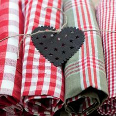 Bring a decorative touch to your kitchen with our checked tea towel. Its square shape makes it perfect for all kinds of household tasks from drying dishes to a napkin for the table. Features a loop at each corner for hanging. Would make for a cute Christmas accent!