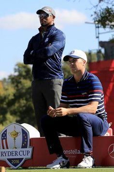 Vice-captain Tiger Woods of the United States speaks to Jordan Spieth during practice prior to the 2016 Ryder Cup at Hazeltine National Golf Club on September 29, 2016 in Chaska, Minnesota.