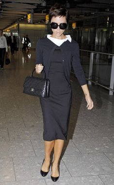 Victoria Beckham Cardigan  Victoria Beckham looked super-cute in a black cardigan and LBD.