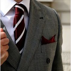 Dark grey glen plaid double-breasted jacket, white shirt, red tie with white stripes