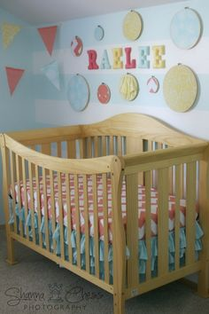 Coral + Aqua Nursery - love the subtle stripes and wall decor! #nursery #nurserydecor