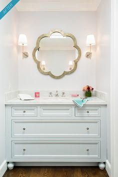 White/very light blue vanity, marble top, and love the added feet on edges to look like furniture