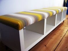 Turn a bookcase on its side, and add a DIY pillow top. Instant seat with storage underneath