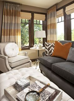 I LOVE this color palette of slate gray, blue, orange, and ivory...especially with the dark brown window panes. draperies colors