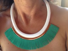 White rope necklace with gold detail & green fringe.
