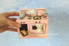 Tutorial for this stove http://www.cinderellamoments.com/2014/04/vintage-style-dollhouse-miniature-stove.html