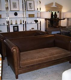 Pair of A. Rudin sofas.