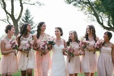 Mismatched Bridesmaid dresses in shades of blush.