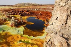 Danakil Depression in Ethiopia, where the ground springs forth with lava and hot mineral springs that evaporate and leave salt formations behind.