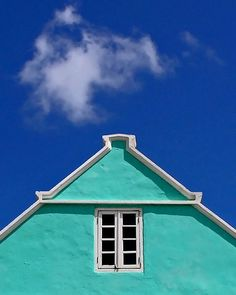 turquoise building and blue sky