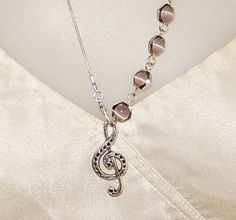 Pink Cat's Eye necklace  Silver music by MYHIGHSTREETBOUTIQUE, $20.00