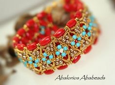 so love the color combination - tomato, turquoise, and gold.  beautiful!!!