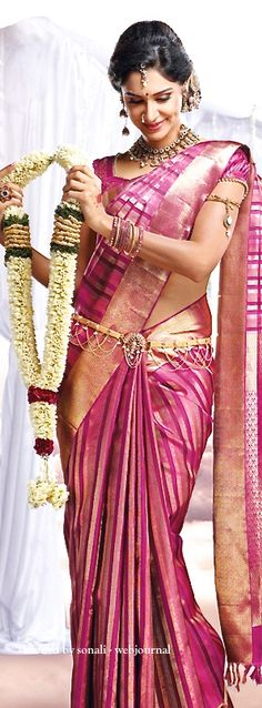 South Indian bride. Temple jewelry.Pink silk kanchipuram sari. Braid with fresh flowers. Tamil bride. Telugu bride. Kannada bride. Hindu bride. Malayalee bride