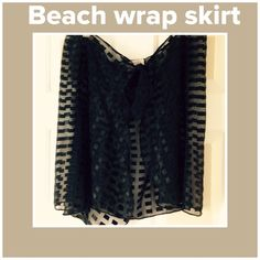 Black sheer checkered pattern wrap skirt Great for beach cover up. One size waist tie. New condition. Sand Dollar Swim Coverups