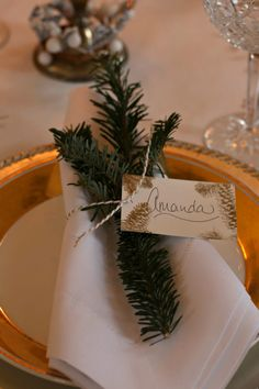 Simple place setting with evergreen and baker's twine.