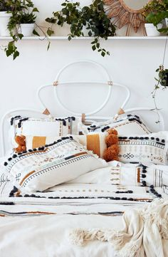 boho bedding and throw pillows with tassels