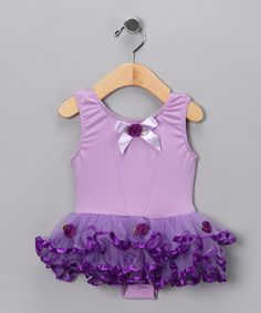 Little kittens will look purrfect in this skirted bodysuit decorated with a pretty bow and pink ruffles. Though it looks like a dress, bodysuit snaps under the skirt allow for quick and easy changing so little stars can get back to doing what they do best: stealing the show with smiles.98% polyester / 2% spandexHand wash