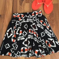 "SKIRT Trendy fun Aztec black, orange and white skater skirt with banded waist NWT have one S/M and one Large available  16"" length hand wash ❌trades ❌PayPal Always Skirts Mini"