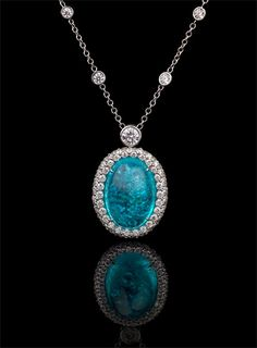 Rare. Radiant. Resplendent. This Brazilian paraiba glows Caribbean blue in a diamond and platinum necklace. Richard Krementz Gemstones