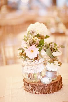 love the yarn & lace wrapped jars!  the assortment of different jars and flowers for a centerpiece