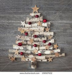 Christmas tree on wooden background - stock photo