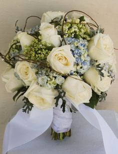 Wedding flowers blue hydrangea twigs cream rose rustic garden.   Flowers of Charlotte Loves this!  Find us at www.charlotteweddingflorist.com