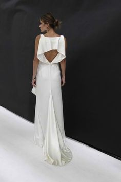 Back view of elegant white gown | http://brideandbreakfast.ph/2010/12/10/fashion-friday-nicole-miller/ | Designer: Nicole Miller