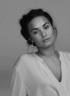 Demi Lovato. I think that she is GORGEOUS all stripped down like this. <3