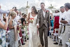 Confetti Shot - St James Club Antigua - Suzanne Neville gown - Beach Wedding