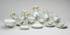 Tea, coffee and chocolate service, Attributed to Johann Gregor Höroldt (1696-1775), Meissen hard-paste porcelain, Note: no handles to bowls with saucers would suggest this set was made before 1750s. Turquoise and white ground decorated with quatrefoil reserves featuring polychrome paintings of land and seascapes. Decorated with simple gilt edges. Royal Collection Trust/© Her Majesty Queen Elizabeth II 2014