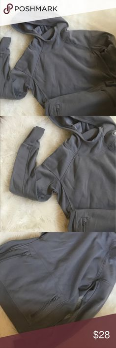 Athleta pull over hoodie Pretty light gray pull over. Fleece lined. Two zip pockets in front. Long sleeves. Size medium. Athleta Jackets & Coats