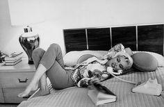 Marilyn Monroe lying down on the phone.