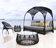 The Gothic-style Hagia Furniture design by Kenneth Cobonpue - Talk about super cool patio furniture!