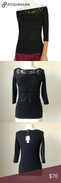 Embellished lace crystal pullover sweater top -Contoured stretch fit -lace and black crystal embellishments -72% rayon, 28% nylon -Small: bust 34 inches, length 25 inches -Medium: bust 37 inches, length 25.5 inches White House Black Market Tops Blouses