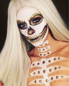 White skull  got inspiration from the amazing @alexfaction and @ladyjessmakeup on there amazing white skull makeup ❤️ Used @makeupforeverirl flash colour palette to create this look and there gold glitters also used @wonderlandmakeup gold pigment in 24k. Wig is @powderroomd in style 'bae watch' #powderroomd #whiteskull #skullmakeup #glitter #makeupforever