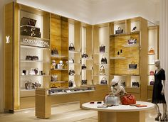 Louis Vuitton wall display cabinets made by gold stainless steel, LED and acrylic