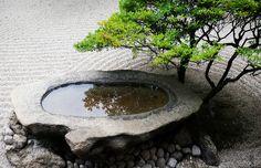 Ritsurin-Japanese-garden-stone-basin | Skye Hohmann Photography and Writing