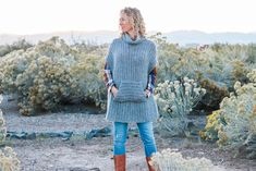 "This simple free crochet poncho pattern is a little more fitted than most, offering a versatile wardrobe staple that's perfect for layering. The pocket and cowl turtleneck crank up the cozy factor! Made with Lion Brand Touch of Alpaca yarn in ""Grey Oxford."""