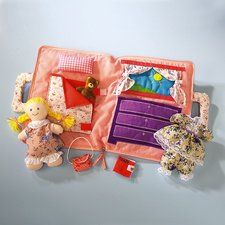 """Cloth Doll With Portable Dollhouse Set by Current. $18.99. Adorable cloth doll comes in a carrying case that opens into a dollhouse! 24-piece set includes: 8"""" tall cotton doll 2 Two-piece Outfits Hat Purse Diary Teddy Bear Dollhouse Pillow Bedspread Curtained window Dresser Pocket"""