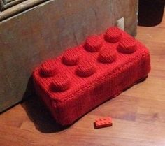 If you've been trying to find a unique way to prop open doors, considering this free knitting pattern for a Knit Leggo Doorstop. Made with a brick and a few bottle caps, knitting up a cozy for this project is super fun and easy to do. Use up your yarn scraps and make something practical (and adorable) for the house at the same time. If you worried about stubbing your toe on the brick inside, consider stuffing your leggo with Poly-fill and make an equally cute knit pillow.