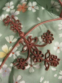 Cheongsam with floral silk button.