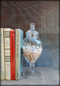 scrabble tiles in a glass jar bookend